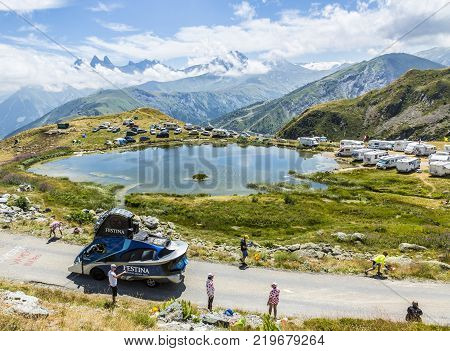 Col de la Croix de Fer France - 25 July 2015: Festina caravan driving on the road to the Col de la Croix de Fer in Alps during the stage 20 of Le Tour de France 2015. Festina is a very old and famous company which produces high quality watches.