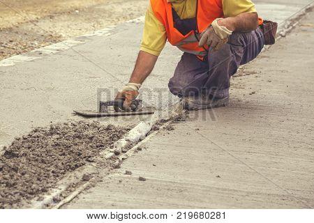 Mason Leveling Concrete With Trowel