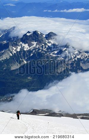 Lone mountaineer climbing Mount Rainier in Washington USA