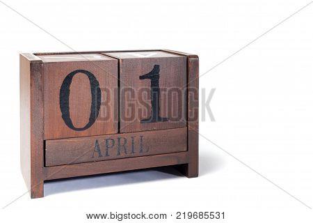 Wooden Perpetual Calendar set to April 1st April Fools Day