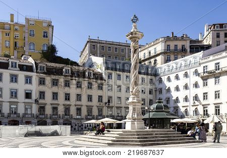 LISBON - September 25, 2017: Pillory of the 18th century made of a a spiral column of a single limestone block crowned by a gilt metal armillary sphere in Municipal Square Lisbon Portugal