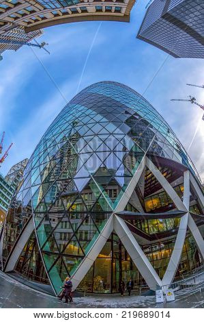 LONDON ENGLAND - NOVEMBER 27 2017: Fish eye view with the famous Gherkin Tower (30 St Mary Axe).