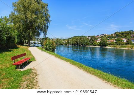 The Rhine river between the city of Schaffhause and the Rhine Falls in Switzerland in summertime.