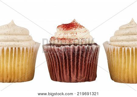 Close up with three delicious birthday cupcakes isolated on white background.