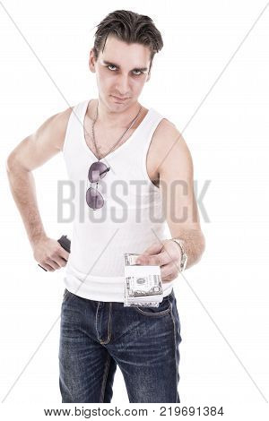 Bad guy holding a handgun in his back and offering cash money. Isolated on white background.