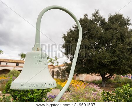 El Camino Real cast iron bell in garden of the Mission at San Juan Capistrano, California