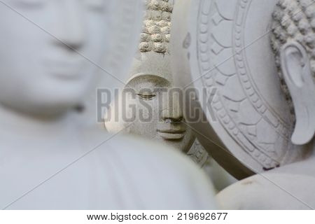 Face of Limestone Buddhist state in Wat Pha Sawang Boon Nakornnayok Thailand