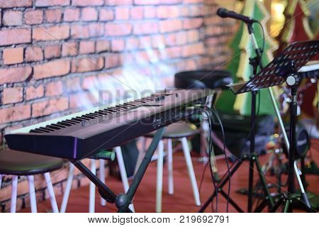 Musical instruments in a room. Electric piano microphone and stand