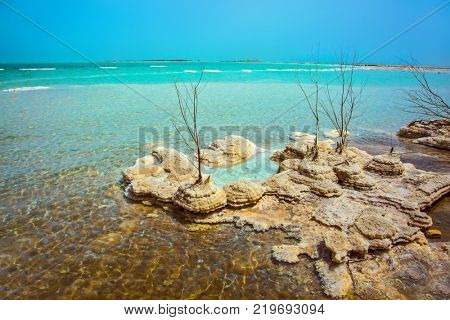 Picturesque islands of medicinal salt in the lake. Israel, spring. Forever Living Dead Sea. The concept of ecological and therapeutic tourism
