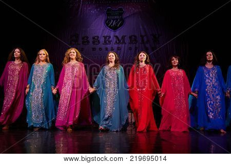 MOSCOW, RUSSIA - OCT 21, 2017: Female participants dance haligi during Gala Concert on stage of Luna Theatre after 12th international festival of oriental dance ASSEMBLY 2017.