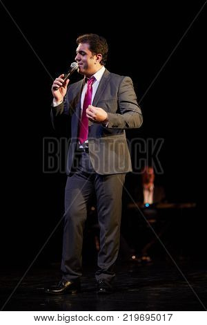 MOSCOW, RUSSIA - OCT 21, 2017: Yasser Alama professional singer and composer, organizer of 12th international festival of oriental dance ASSEMBLY 2017 on stage of Luna Theatre during Gala Concert.