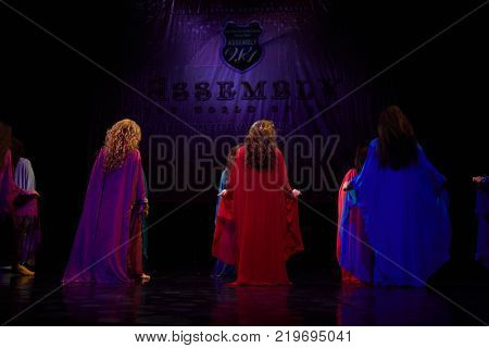 MOSCOW, RUSSIA - OCT 21, 2017: Women bellydancers on stage of Luna Theatre dance haligi during Gala Concert after 12th international festival of oriental dance ASSEMBLY 2017.