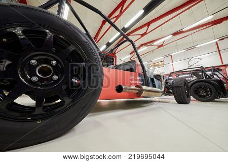 MOSCOW, RUSSIA - OCT 27, 2017: (PR) Racing cars in garage of DB 527 company producer of russian sports cars. Cars based on Lotus Seven legendary model.