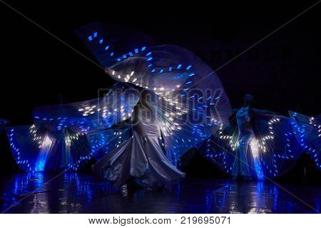 MOSCOW, RUSSIA - OCT 21, 2017: Female dancers on stage of Luna Theatre during Gala Concert after 12th international festival of oriental dance ASSEMBLY 2017.