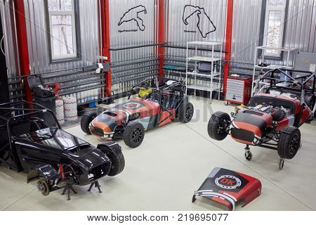 MOSCOW, RUSSIA - OCT 27, 2017: (PR) Several racing cars ShortCuts  based on the legendary Lotus Seven on wheeled rack in garage of DB 527 company producer of russian sports cars.