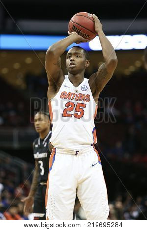 NEWARK, NJ - DEC 9: Florida Gators Keith Stone (25) shoots a free throw during the game against the Cincinnati Bearcats on December 9, 2017 at the Prudential Center on  Newark, New Jersey.
