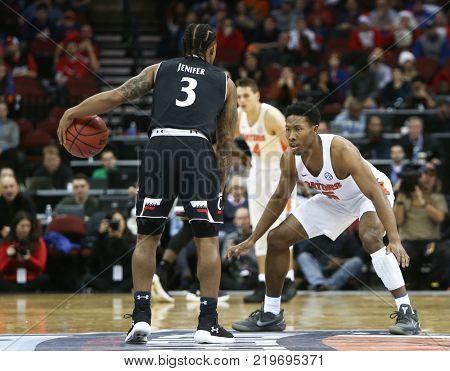 NEWARK, NJ-DEC 9: Florida Gators guard KeVaughn Allen (5) defends as Cincinnati Bearcats guard Justin Jenifer dribbles (3) on December 9, 2017 at the Prudential Center on  Newark, New Jersey.