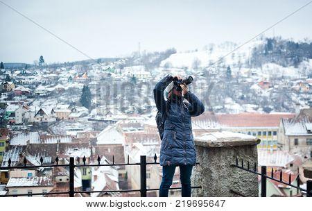 woman tourist - winter city break in Sighisoara, Romania