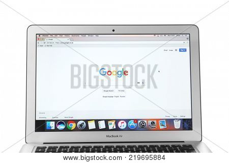 KYIV, UKRAINE - NOVEMBER 13, 2017: MacBook Air Silver with Google search page on white background, designed and developed by Apple Inc