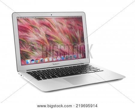 KYIV, UKRAINE - NOVEMBER 13, 2017: MacBook Air Silver with home screen on white background, designed and developed by Apple Inc