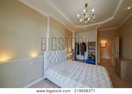 Interior of modern room with double bed.