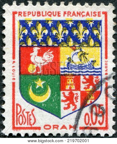 FRANCE - CIRCA 1960: A stamp printed in France depicts Arms of Oran (Algeria) circa 1960
