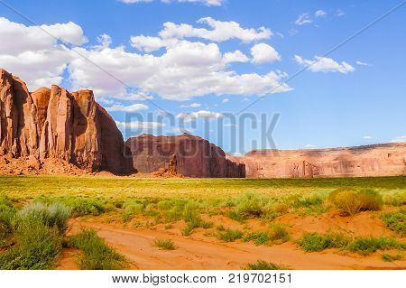Monument valley seen from the prairie with sun