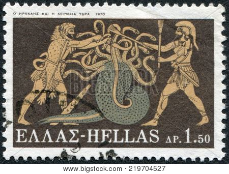 GREECE - CIRCA 1970: A stamp printed in Greece shows the image on the amphora the battle of Hercules with Lernaean Hydra circa 1970