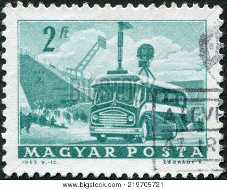 HUNGARY - CIRCA 1963: A stamp printed in Hungary is depicted Mobile radio transmitter and stadium circa 1963
