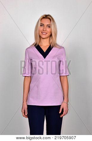 Caucasian blonde young medic doctor portrait.
