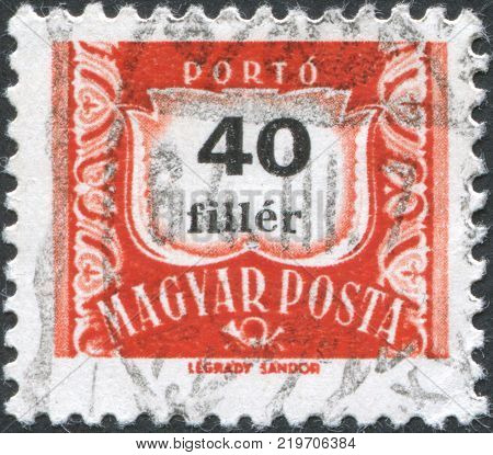 HUNGARY - CIRCA 1958: A stamp printed in Hungary is depicted porto-mark a shield face value 40 filler circa 1958