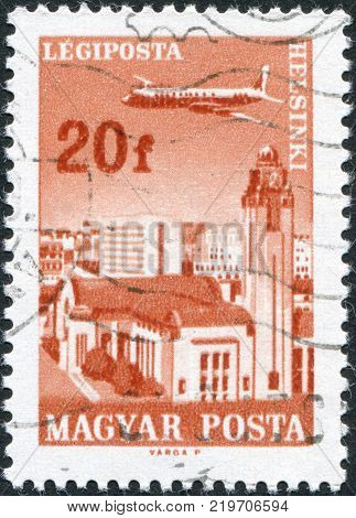 HUNGARY - CIRCA 1966: A stamp printed in Hungary is depicted Helsinki airplane Grand Central Station and the Central Post Office circa 1966