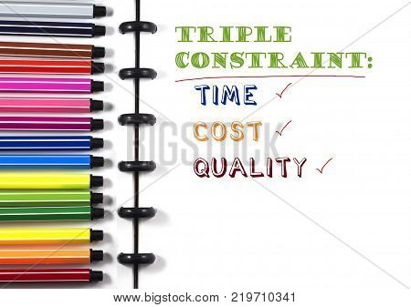 Project Management Triple constraint text on white sketchbook with color pen, top view