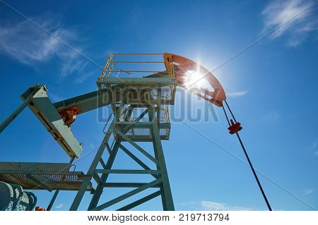 Pumpjack. A pumpjack is the overground drive for a reciprocating piston pump in an oil well. The arrangement is commonly used for onshore wells producing little oil. Pumpjacks are common in oil-rich areas.