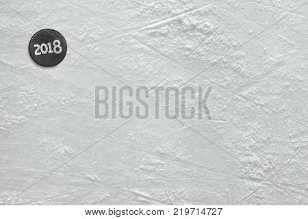 Fragment of ice hockey rink with the puck the new season. Concept hockey