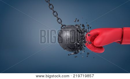 3d rendering of swinging wrecking ball crashes when collides with a huge red boxing glove. Business and success. Fight against trouble. Withstand bad times.