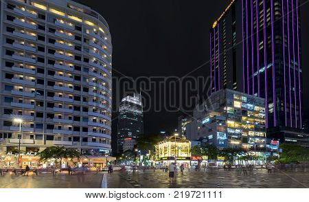 Ho Chi Minh City, Vietnam - December 21st, 2017: Night view on pedestrian street with wide path along the skyscrapers many lights show urban economic development in Ho Chi Minh City, Vietnam