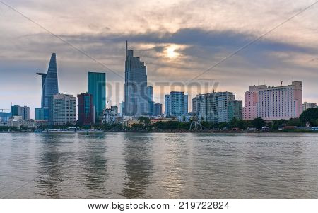 Ho Chi Minh City, Vietnam - December 24th, 2017: Architecture of skyscrapers in the riverside urban area in the winter morning represents the most economic development in Ho Chi Minh City, Vietnam.