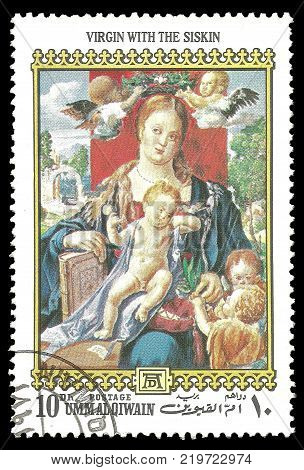 Umm Al Qiwain - circa 1972: Stamp printed by Umm Al Qiwain Color edition on 500th birthday of Albrecht Durer shows Painting Woman With The Siskin circa 1972