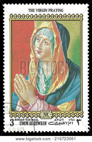 Umm Al Qiwain - circa 1972: Stamp printed by Umm Al Qiwain Color edition on 500th birthday of Albrecht Durer shows Painting The Woman Praying circa 1972