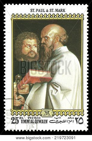 Umm Al Qiwain - circa 1972: Stamp printed by Umm Al Qiwain Color edition on 500th birthday of Albrecht Durer shows Painting St. Paul and St. Mark circa 1972