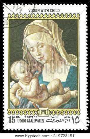 Umm Al Qiwain - circa 1972: Stamp printed by UAE Color edition on 500th birthday of Albrecht Durer shows Painting Woman With Child circa 1972