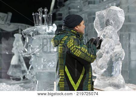 ST. PETERSBURG, RUSSIA - DECEMBER 19, 2017: Sculptor Sergey Nazarov prepares his artwork for the opening of the festival Ice Fantasy - 2018. 180 tonnes of ice was used for creating ice compositions