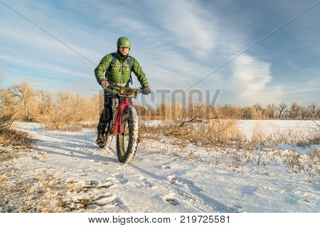 riding a fat mountain bike in winter, cold day in Colorado
