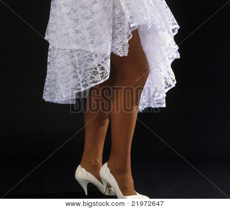 Womans legs in white dress & High Heels