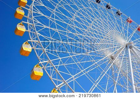 Ferris wheel at Issyk-Kul. A Ferris wheel is a nonbuilding structure consisting of a rotating upright wheel with multiple passenger-carrying components.
