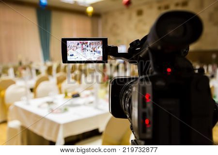 Filming of the event. Videography. Served tables in the Banquet hall.