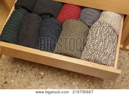 A well-organized open closet drawer. neatly stacked in piles. Storage system. Wardrobe order.