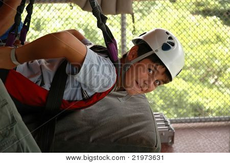Young Boy in Zip Line Harness