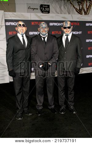 Three suited orcs attend the Netflix